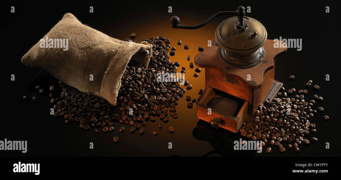 coffee mill and coffee beans on dark background - Stock Image
