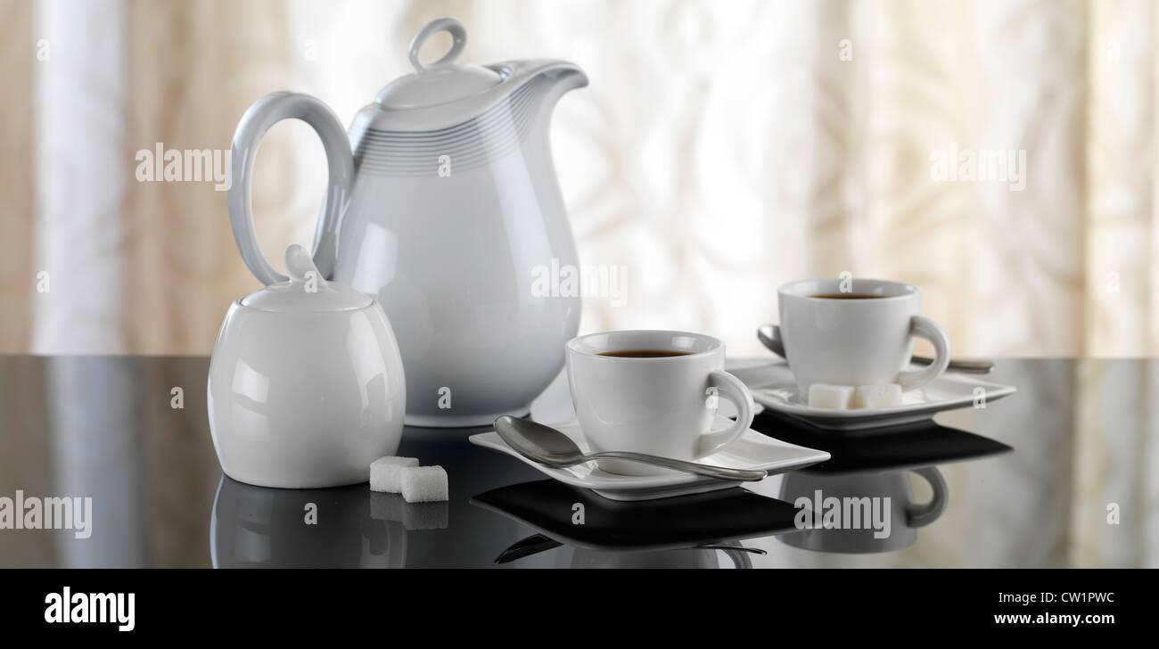 coffee set on reflective table - Stock Image