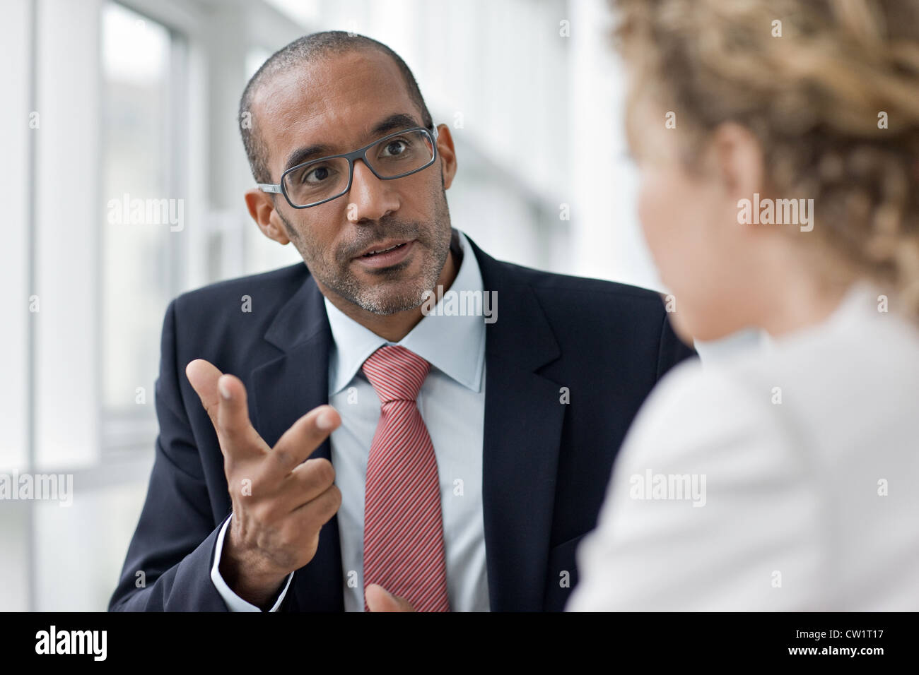 business man woman relationship discussion License free except ads and outdoor billboards - Stock Image