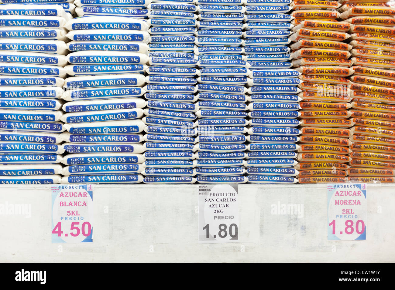 Piles Of Sugar Along With The Price Tag For The 2Kg Bag As Could Be Bought - Stock Image