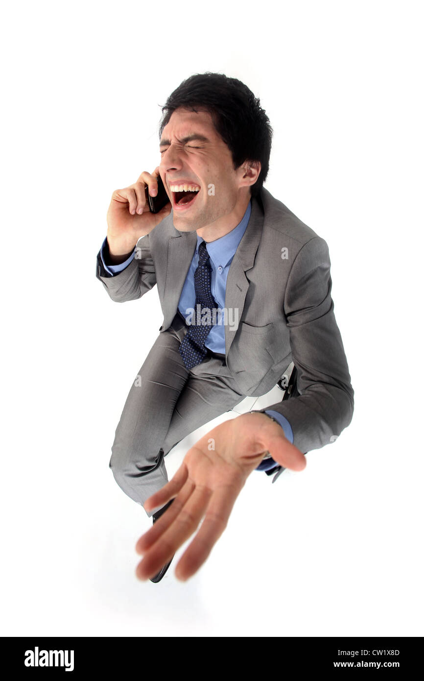 Hysterical businessman on the phone - Stock Image