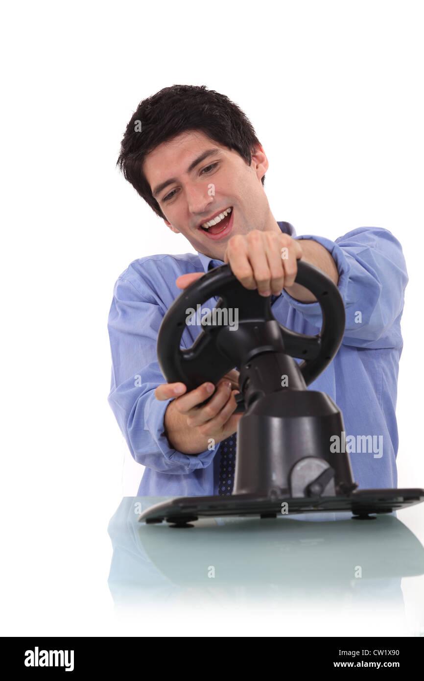 man at wheel - Stock Image