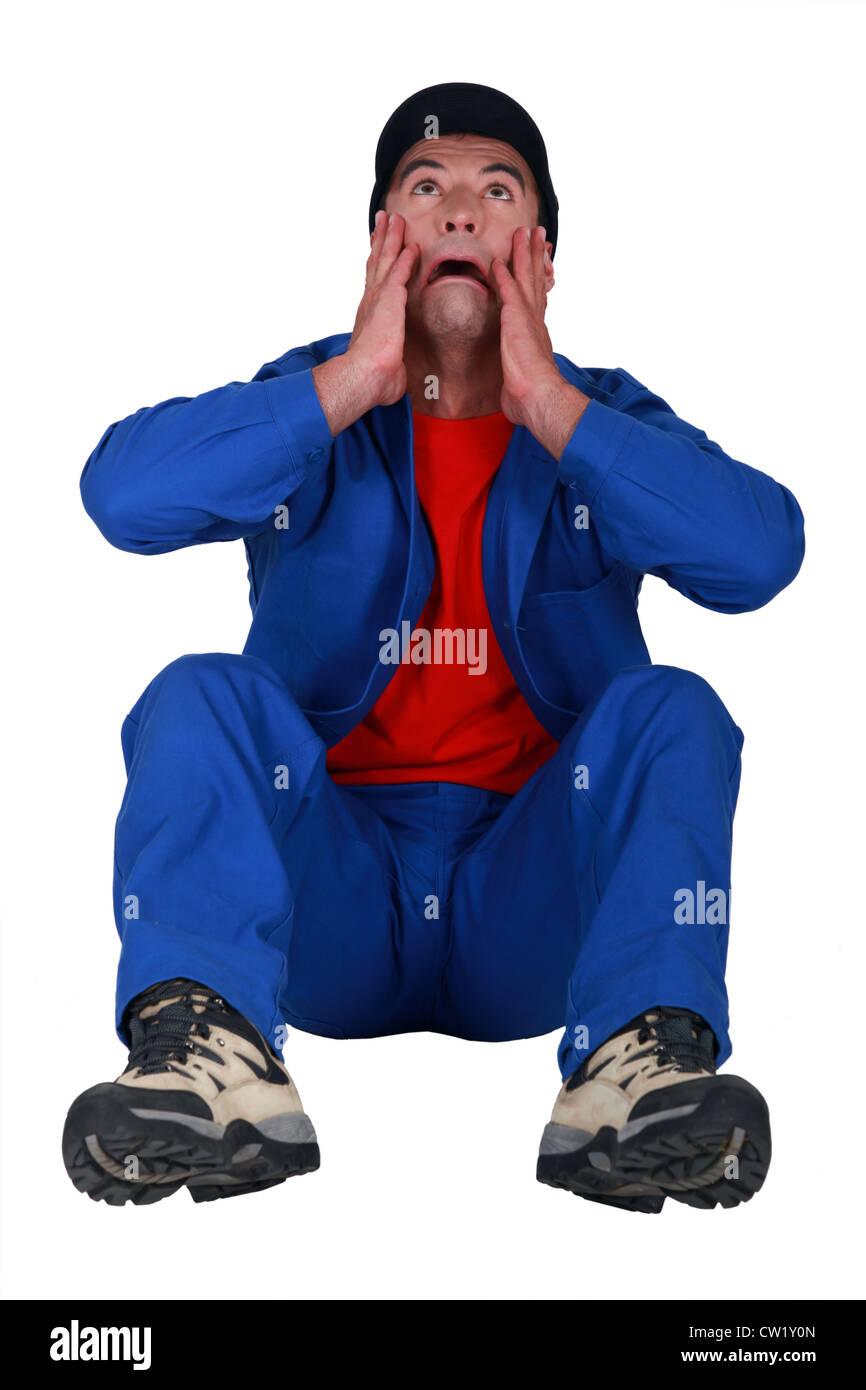 A crying handyman. - Stock Image