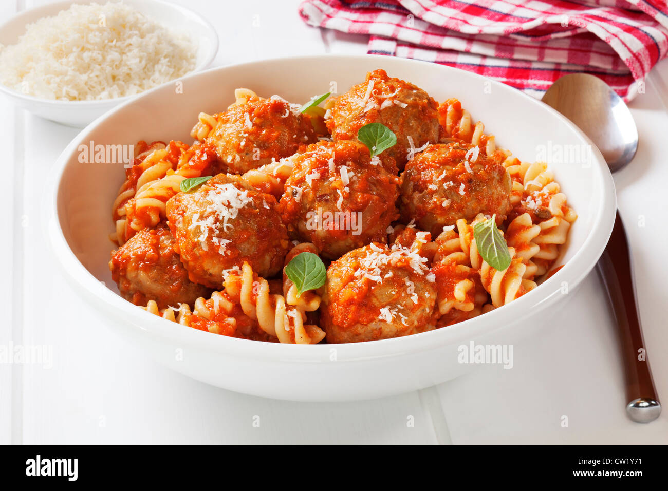 Meatballs with marinara, fusili pasta and parmesan cheese. Meatballs made from turkey mince. - Stock Image