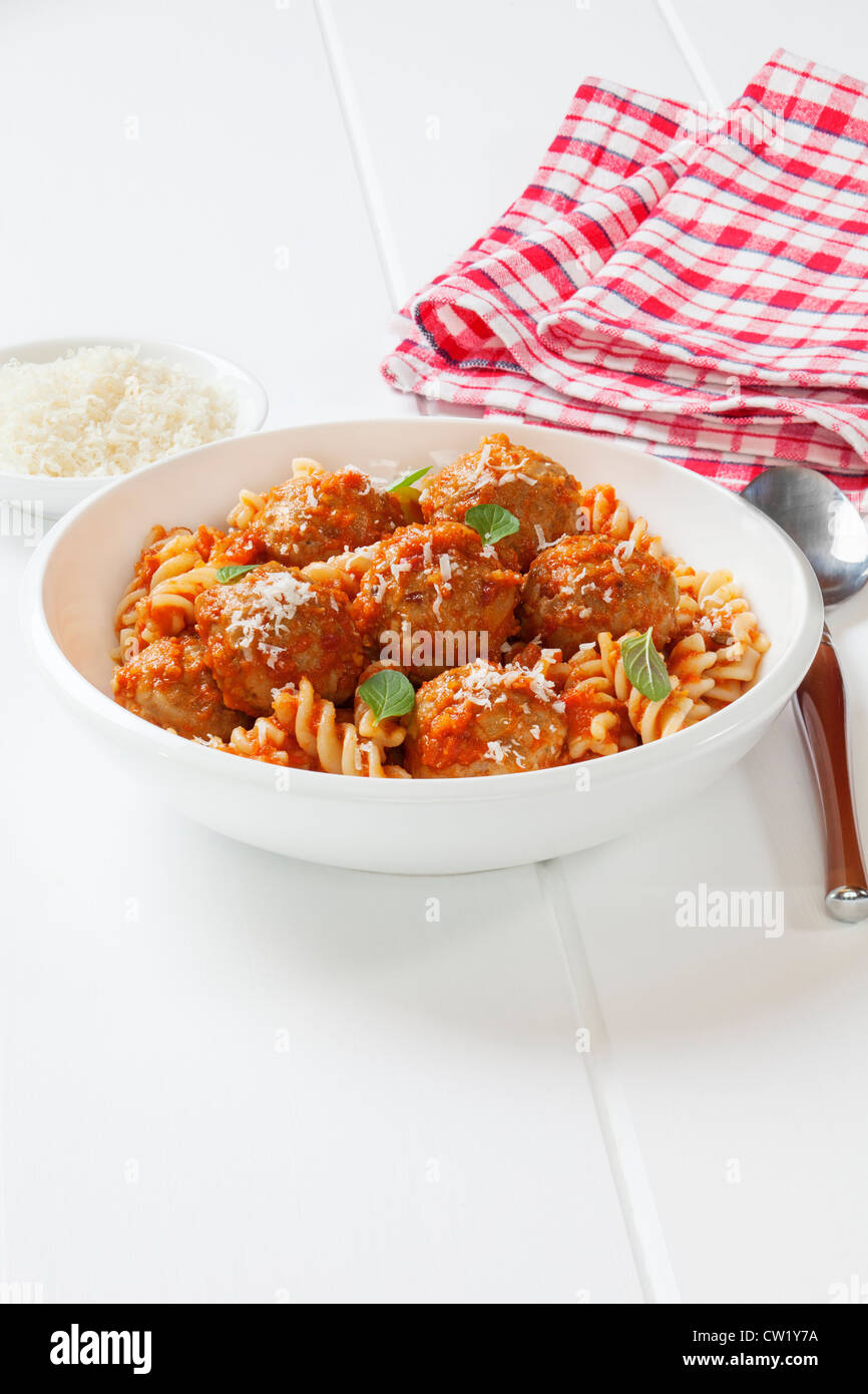 A bowl of meatballs with fusili pasta and tomato sauce, or marinara. Meatballs are made from turkey mince. - Stock Image