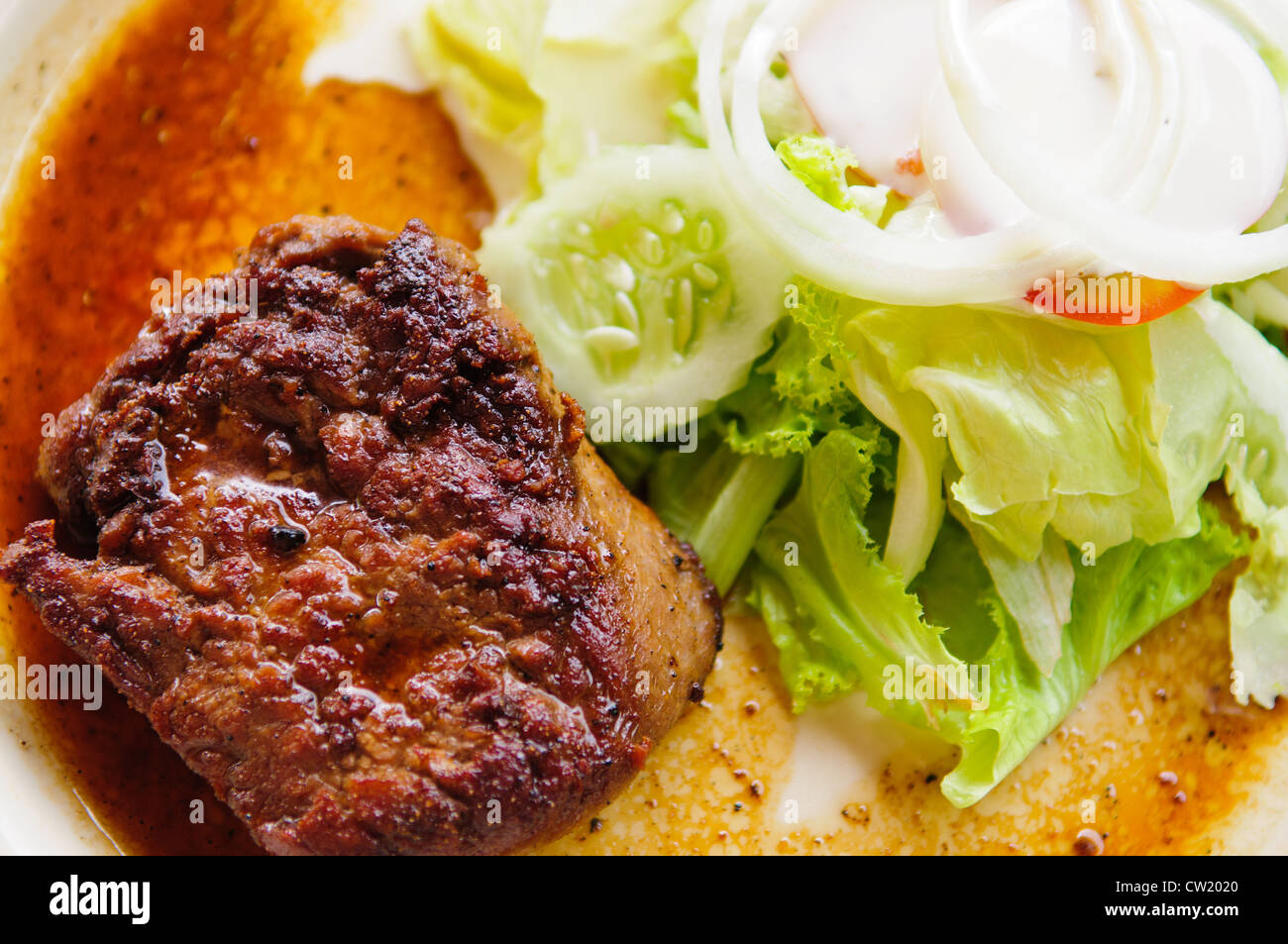 Grilled beef steak with vegetables - Stock Image