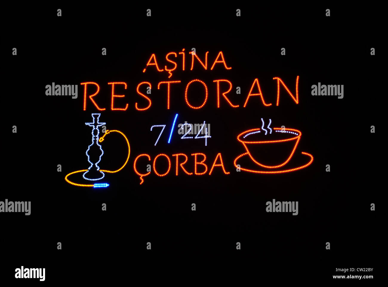 A stylish neon restaurant sign in the Kacimpusa district of Istanbul. Picture by: Adam Alexander/Alamy - Stock Image