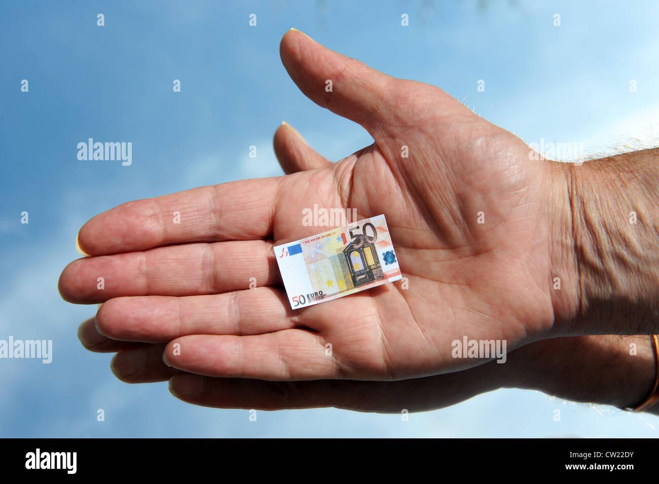 Euro money cash notes in hand euros - Stock Image