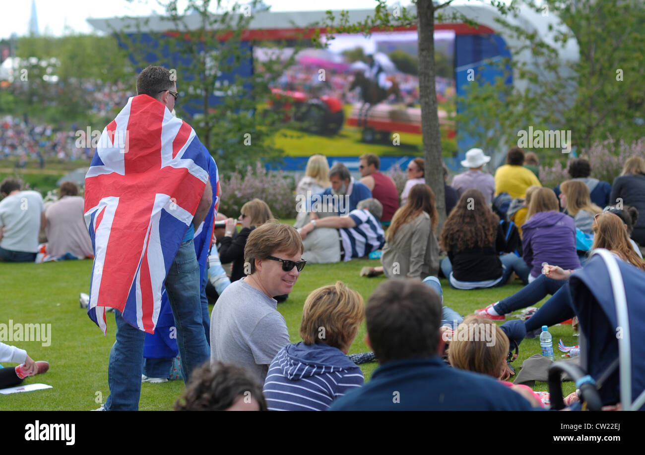 Fans watch the Olympic Games in London on the big Screen in Park Life - Stock Image