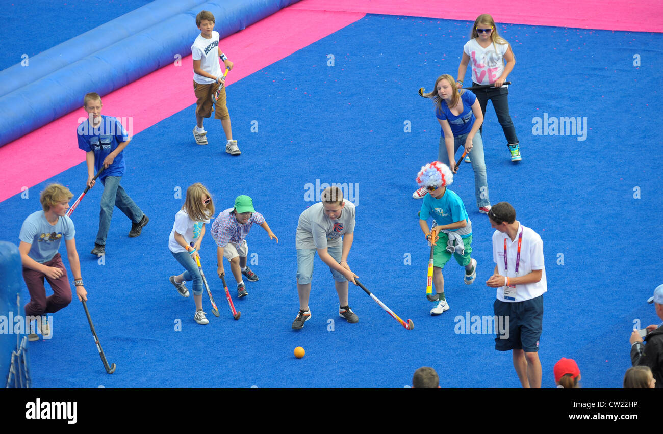 Mini hockey games in the crowd areas at the Olympic hockey tournament - Stock Image
