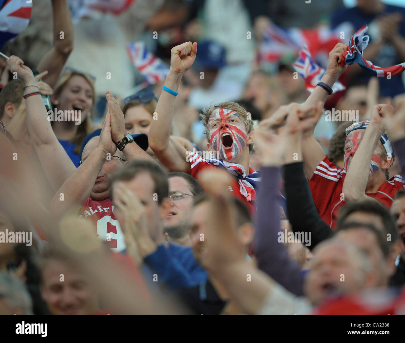 GBR's fans celebrate the 2nd goal during their pool game against Australia in the London 2012 Olympic hockey - Stock Image