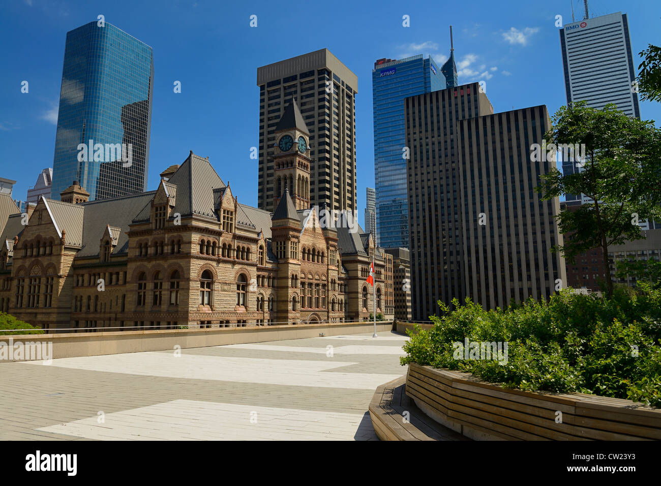 Rooftop garden and patio at Toronto City Hall with old city hall and highrise towers - Stock Image