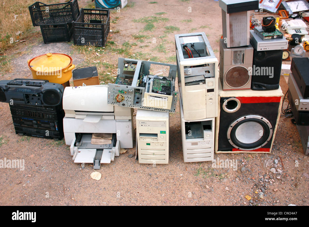 Old computer parts and electronic junk in flea market - Stock Image