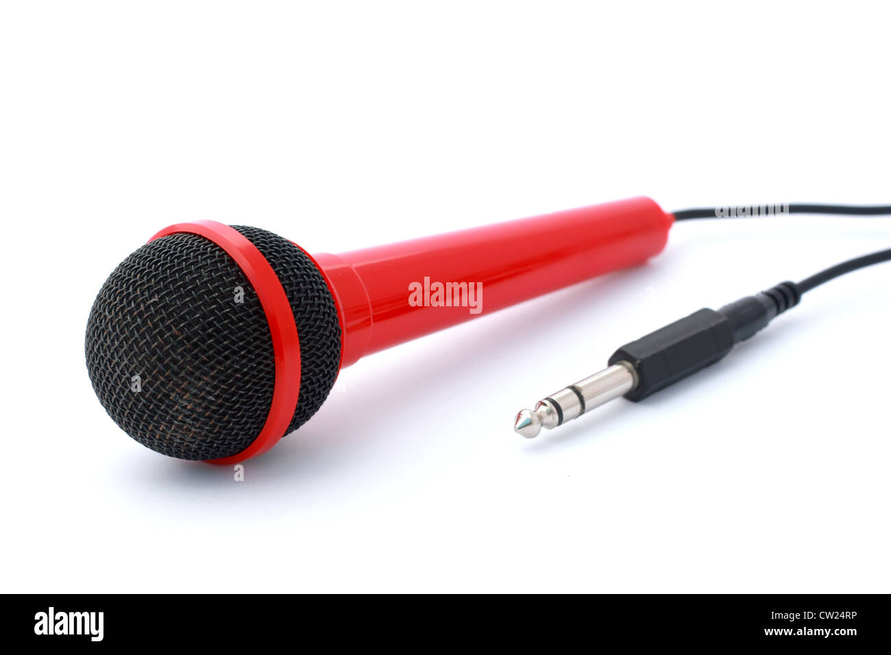 Red Microphone with plug and cable isolated on white with copyspace Stock Photo