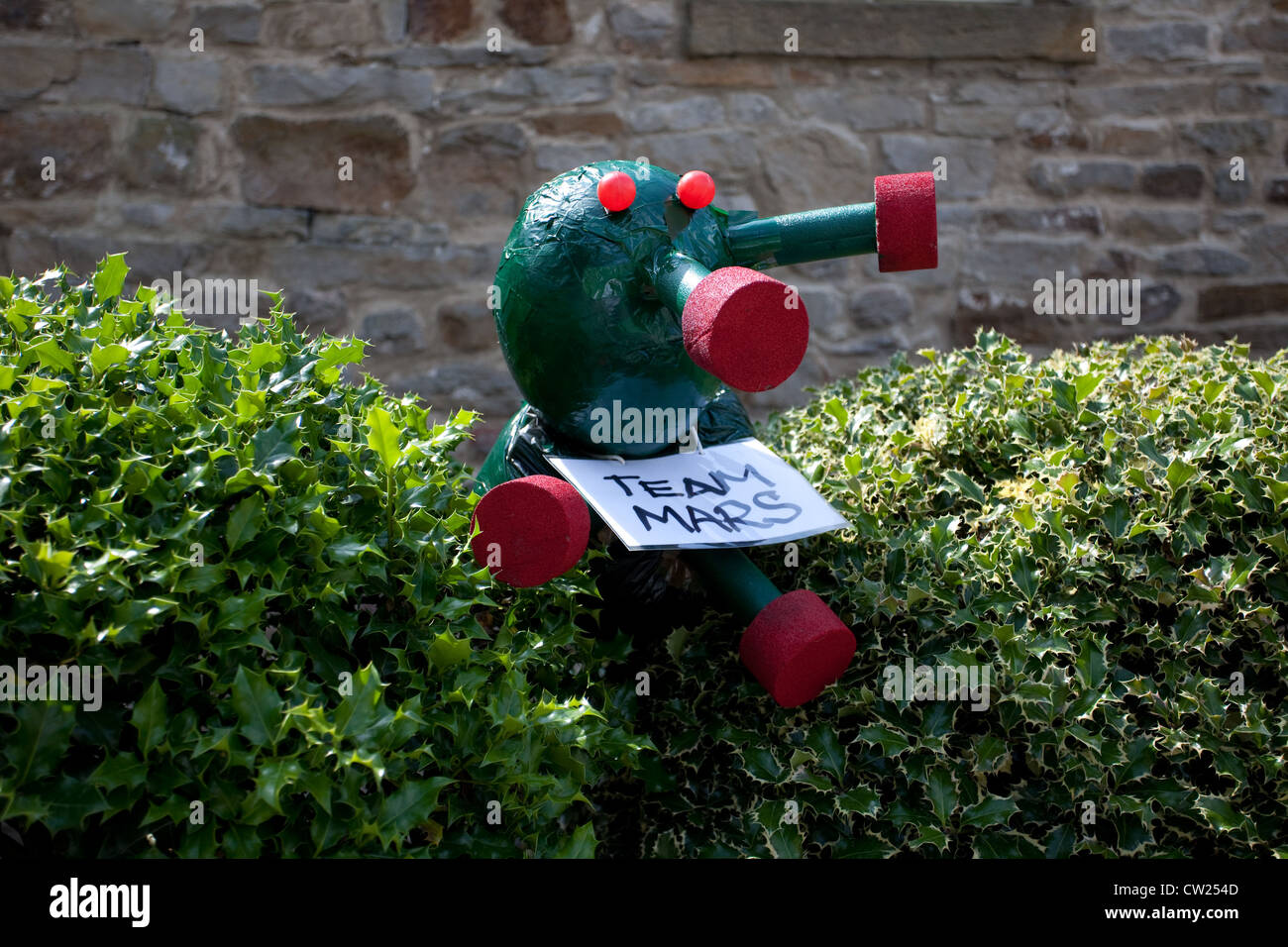 Green Martian Man from Mars art at the 2012 Kettlewell annual Scarecrow festival, Upper Wharfdale, North Yorkshire, - Stock Image