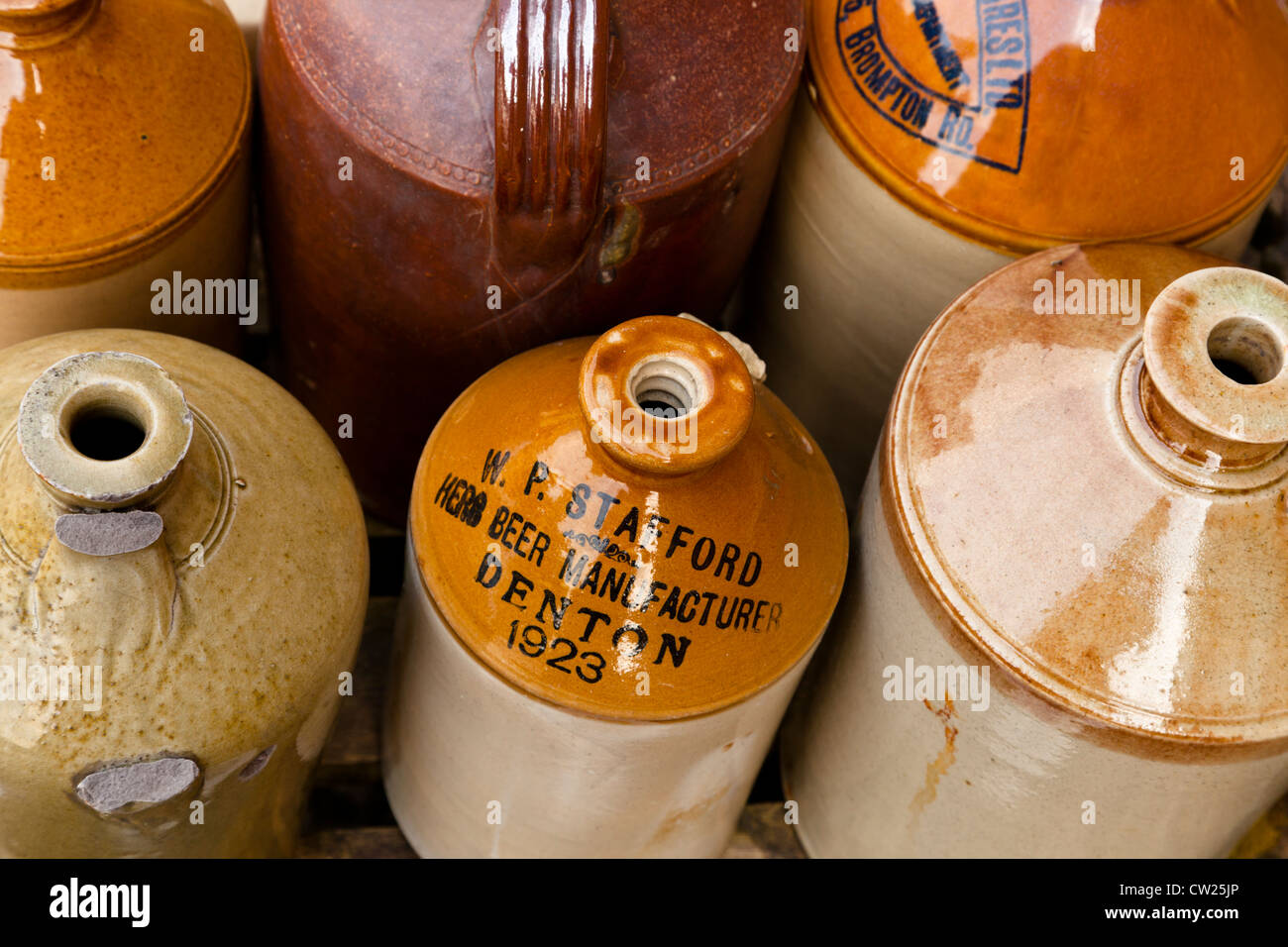 Collection of old stoneware herb or ginger beer flagons manufactured by W P Stafford of Denton - Stock Image