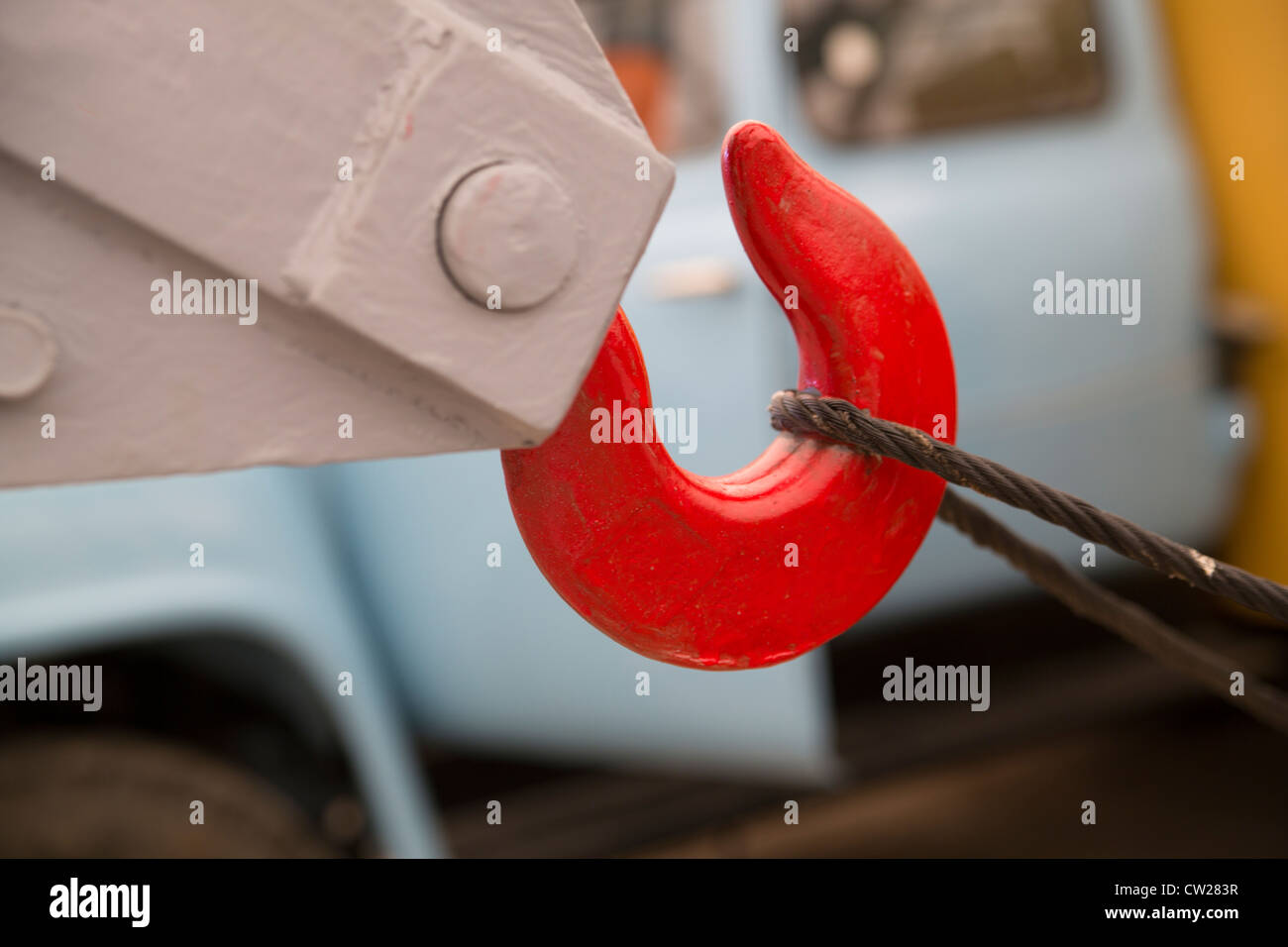 Red hook for removing obstacles is pulls cable - Stock Image