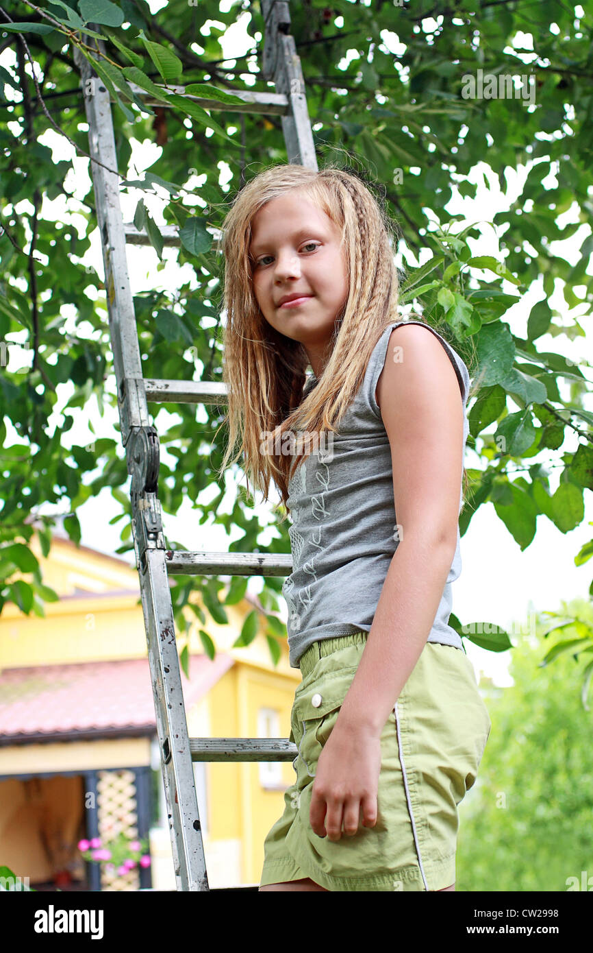 A 12 Years Old Girl In The Garden Stock Photo: 49838356