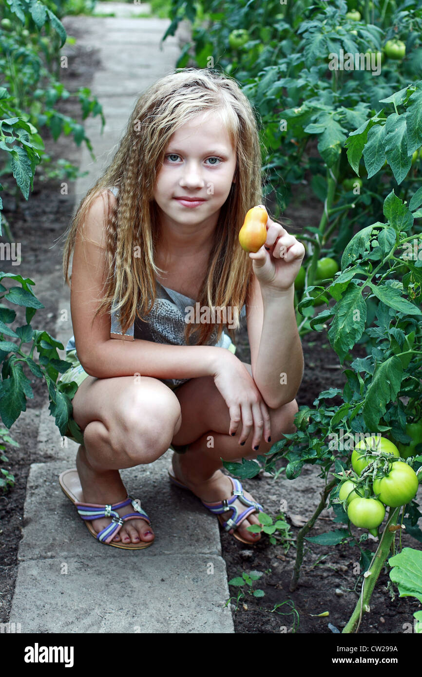 A 12 Years Old Girl In The Greenhouse Stock Photo