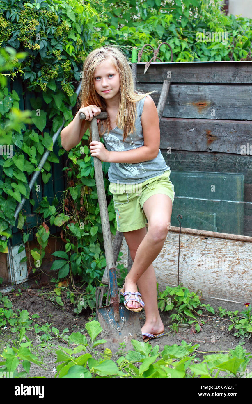 A 12 Years Old Girl In The Garden Stock Photo: 49838365