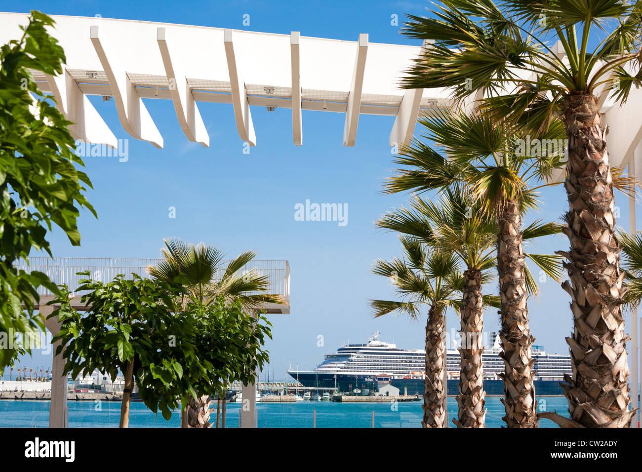 Malaga Spain. Cruise ship with palms. Modern harbor boulevard promenade El Palmeral de las Sorpresas with Holland - Stock Image
