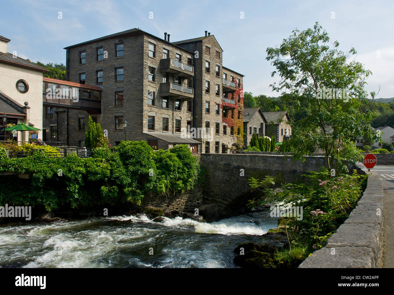 The Whitewater Hotel and the River Leven at Backbarrow, South Lakeland, Cumbria, England UK - Stock Image