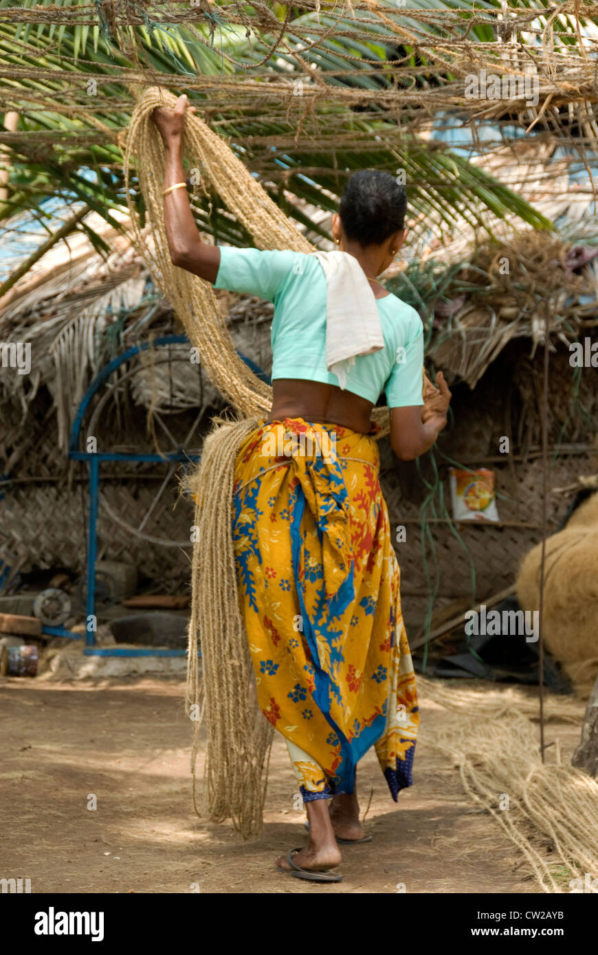 Keralite woman spinning out cord made out of coir - coconut product - Alappuzha, Kerala - Stock Image