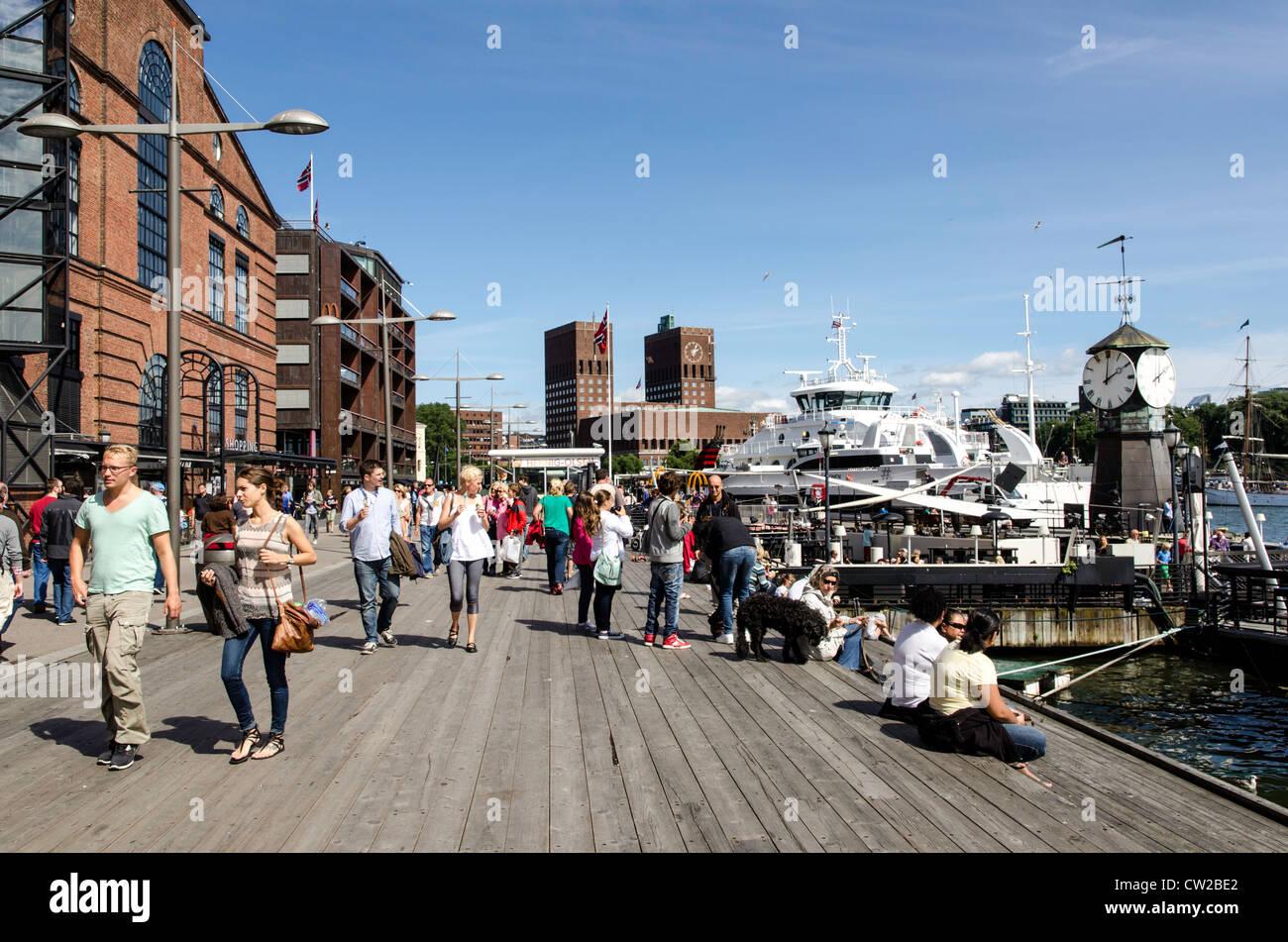 People walking by the waterfront Oslo Norway Scandinavia - Stock Image