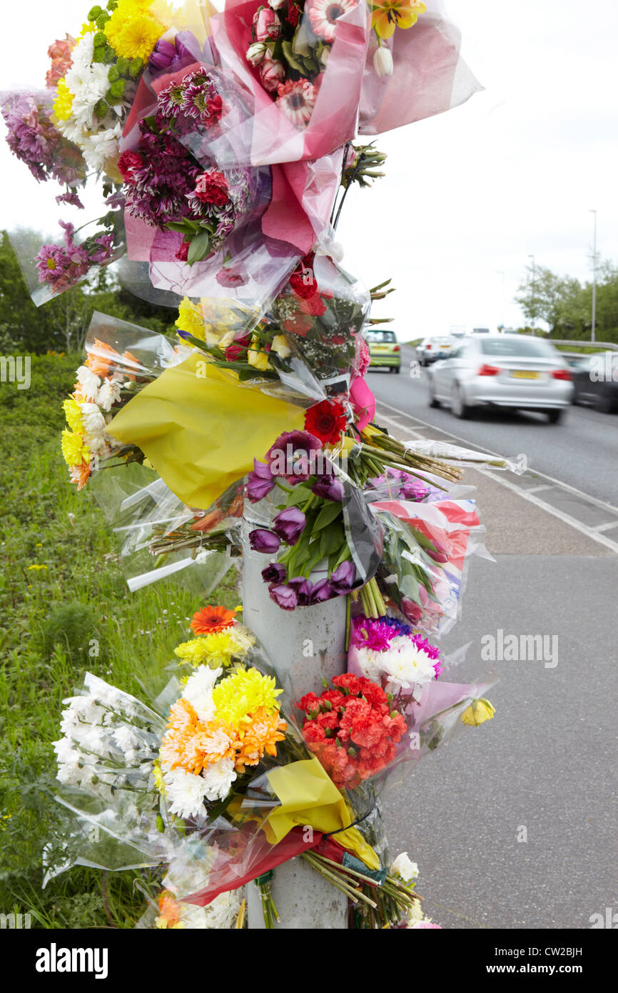 Floral Tributes At Site Of Fatal Traffic Accident Stock Photo