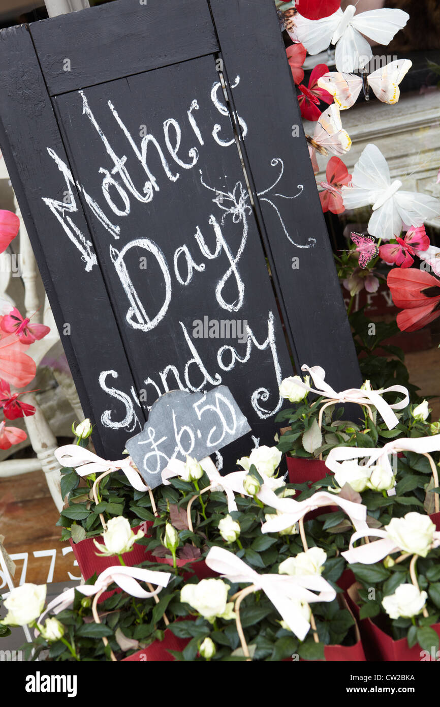 Sign Promoting Mother's Day Outside Shop - Stock Image