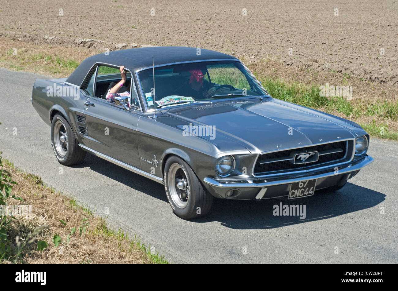 Ford mustang coupe of 1967 in the tour de bretagne near pordic in