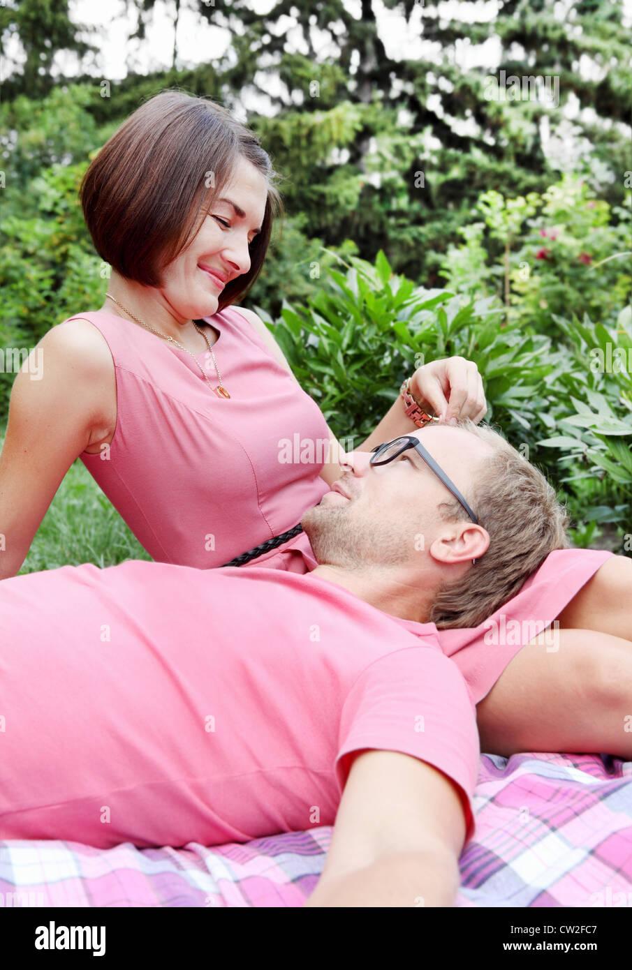 Woman Fondling Man Lovers Sitting on Picnic Stock Photo