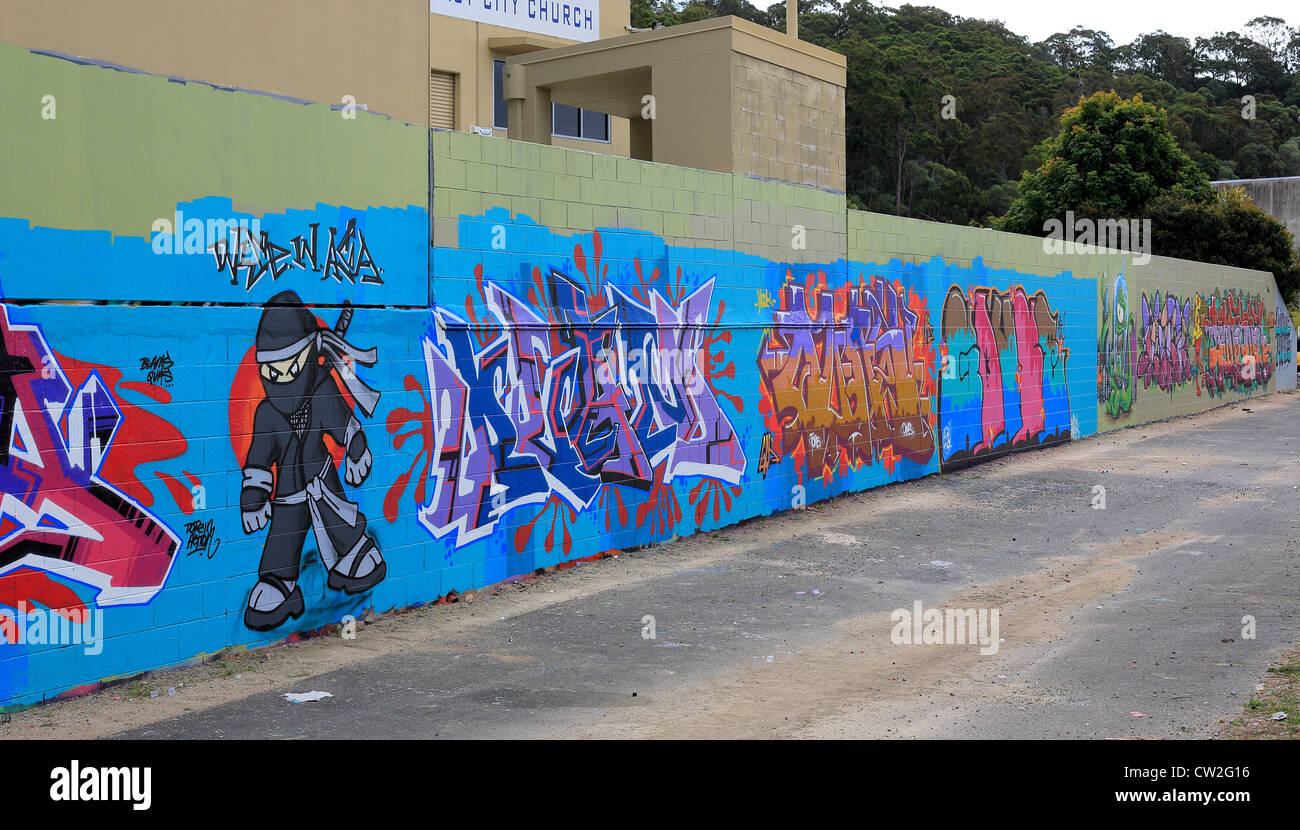 Street art in an allowed area owners of vacant walls encourage street artists to apply their art and not deface - Stock Image