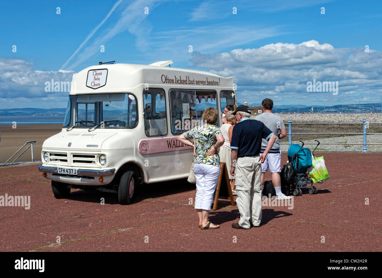People buying ice creams from an ice cream van on the promenade in Morecambe, Lancashire - Stock Image