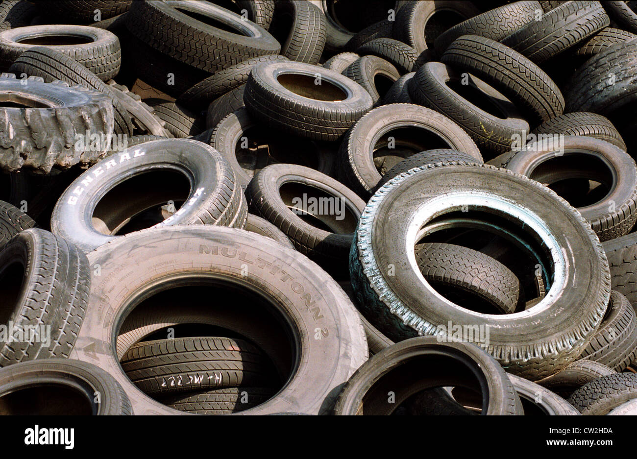 Old car tires on a dump, Brandenburg Stock Photo