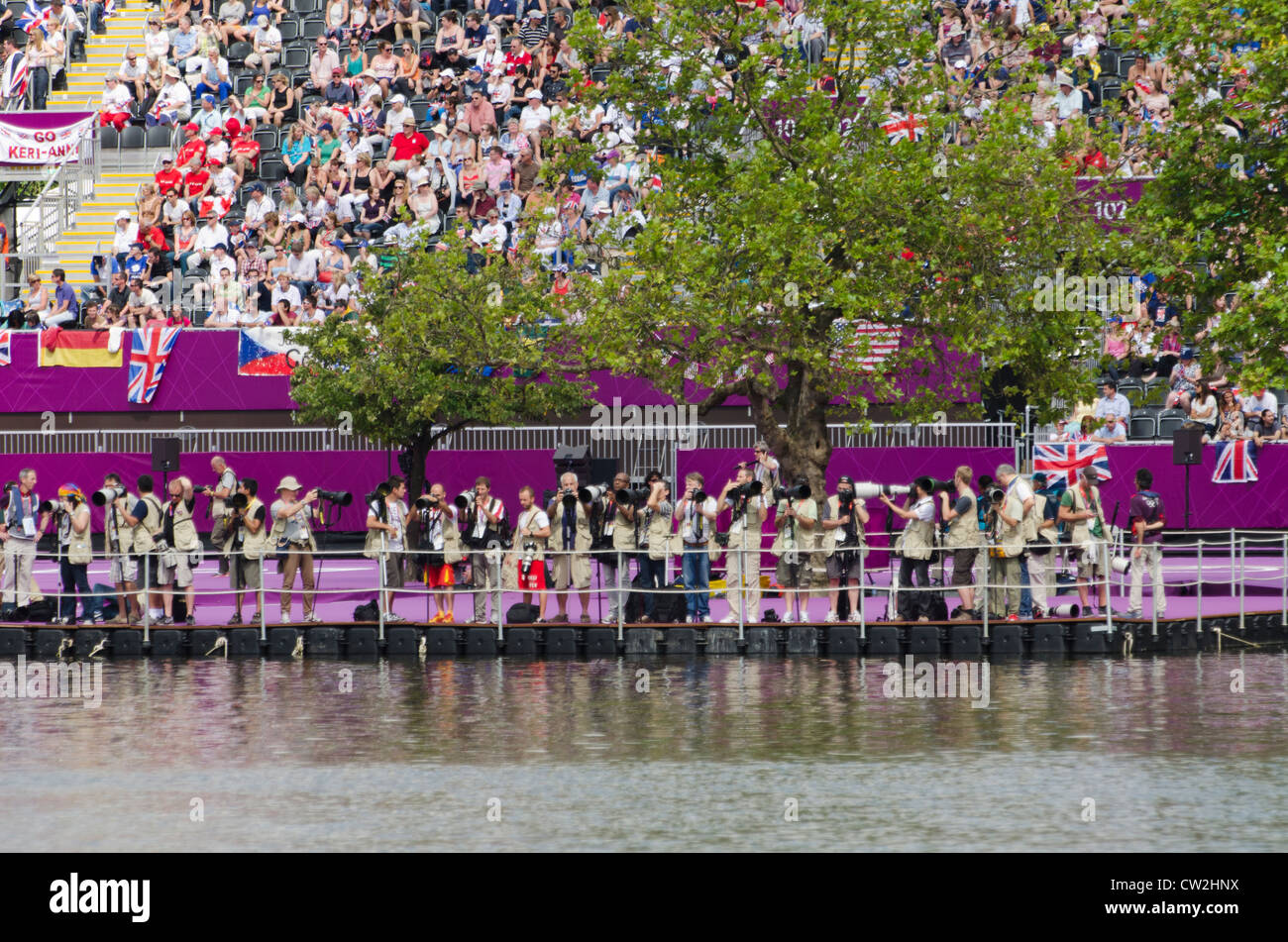 spectators and cameramen at the Women's 10km open water marathon swim London 2012 Olympics Hyde Park Serpentine - Stock Image