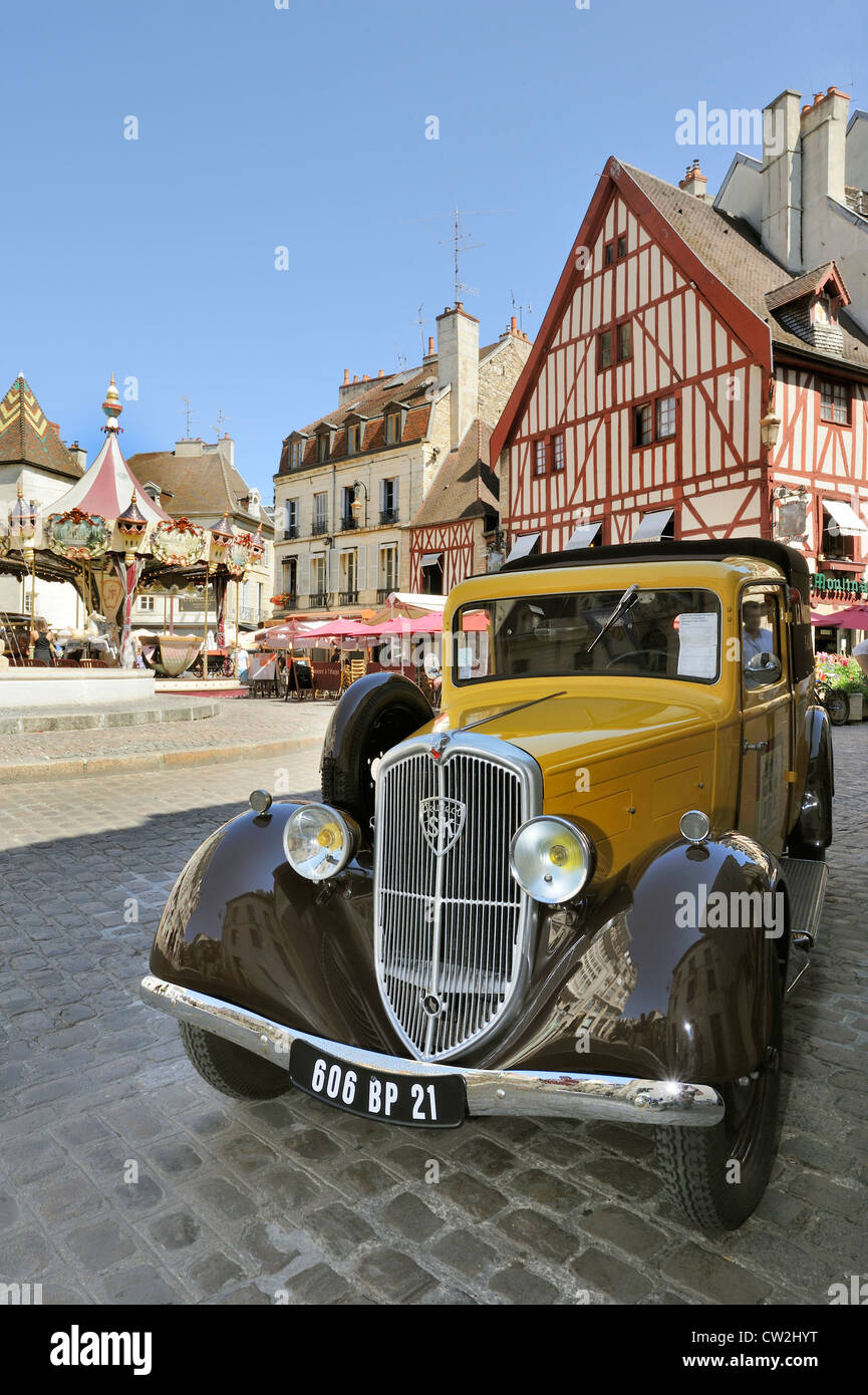 Old car, carousel and architecture in Dijon, France Stock Photo