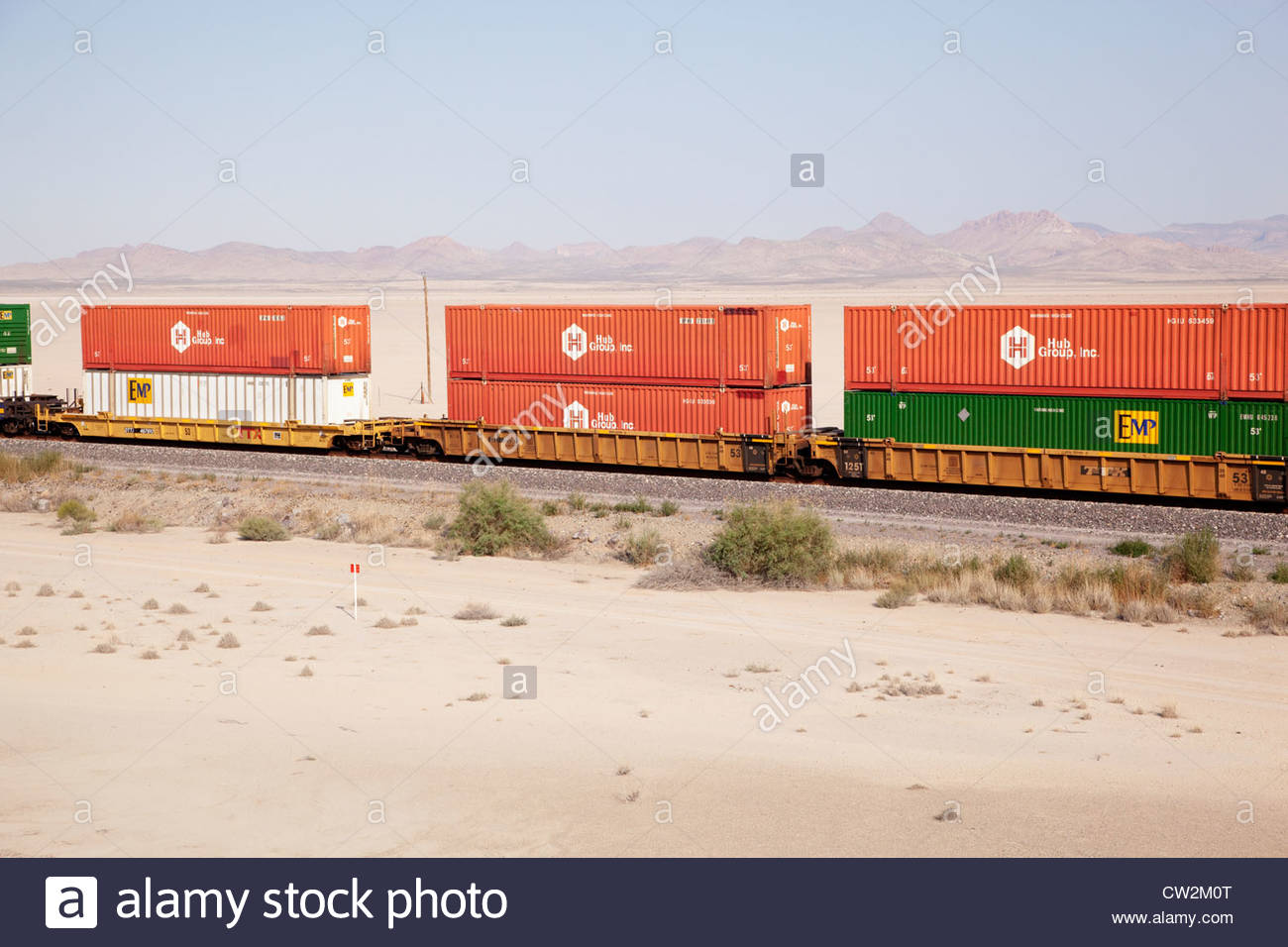 """Shipping containers on rail cars """"New Mexico"""" Stock Photo"""