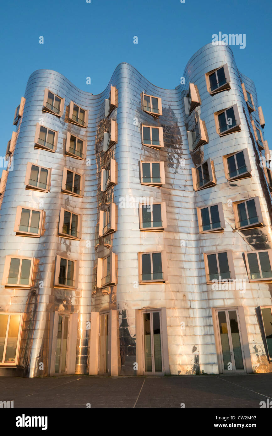 Neuer Zollhof buildings designed by Frank Gehry in Medienhafen in Düsseldorf Germany - Stock Image