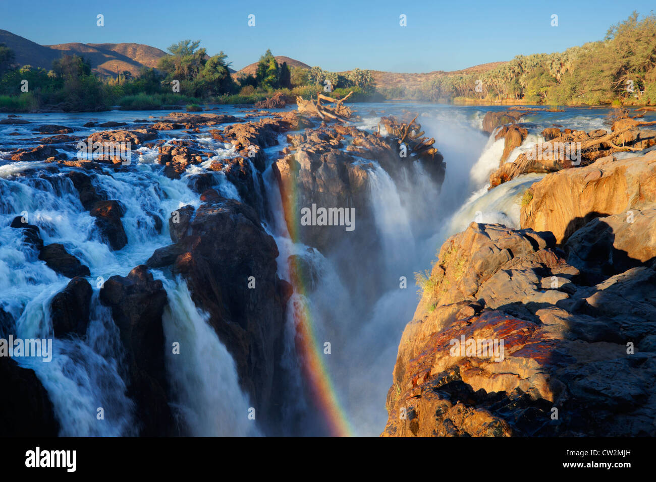 A Rainbow over the Epupa Falls on the Kunene River.Namibia - Stock Image
