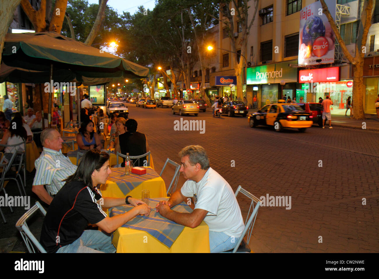 Mendoza Argentina Avenida San Martin street scene commercial district busy avenue sidewalk nightlife shopping alfresco - Stock Image