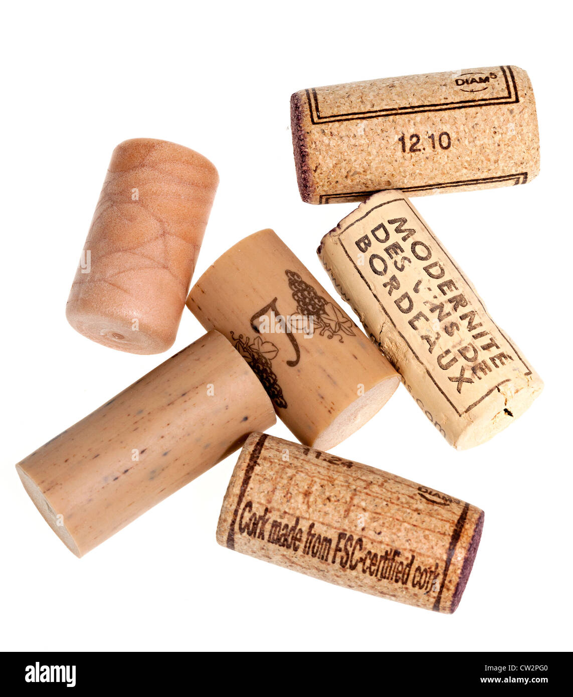 Natural and artificial corks with one marked made from FSC certified cork - Stock Image