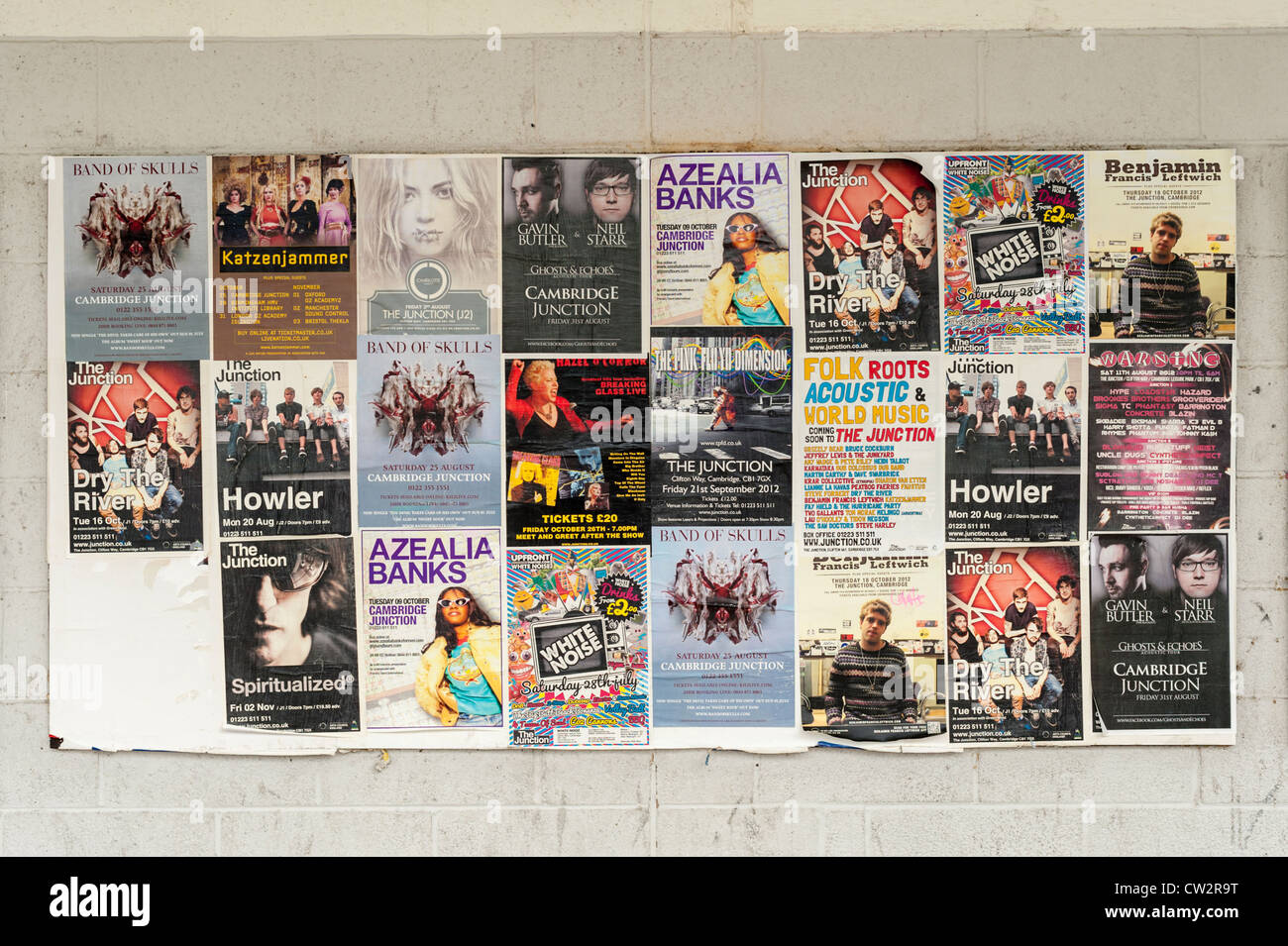 Posters stuck on a wall outside the Junction Theatre and gig venue  Cambridge - Stock Image