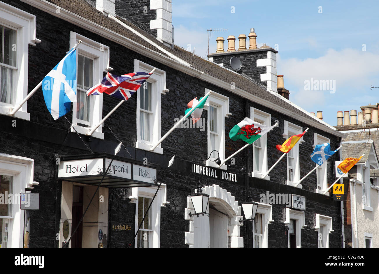 British flags flying outside the Imperial Hotel, Castle Douglas south west Scotland UK - Stock Image