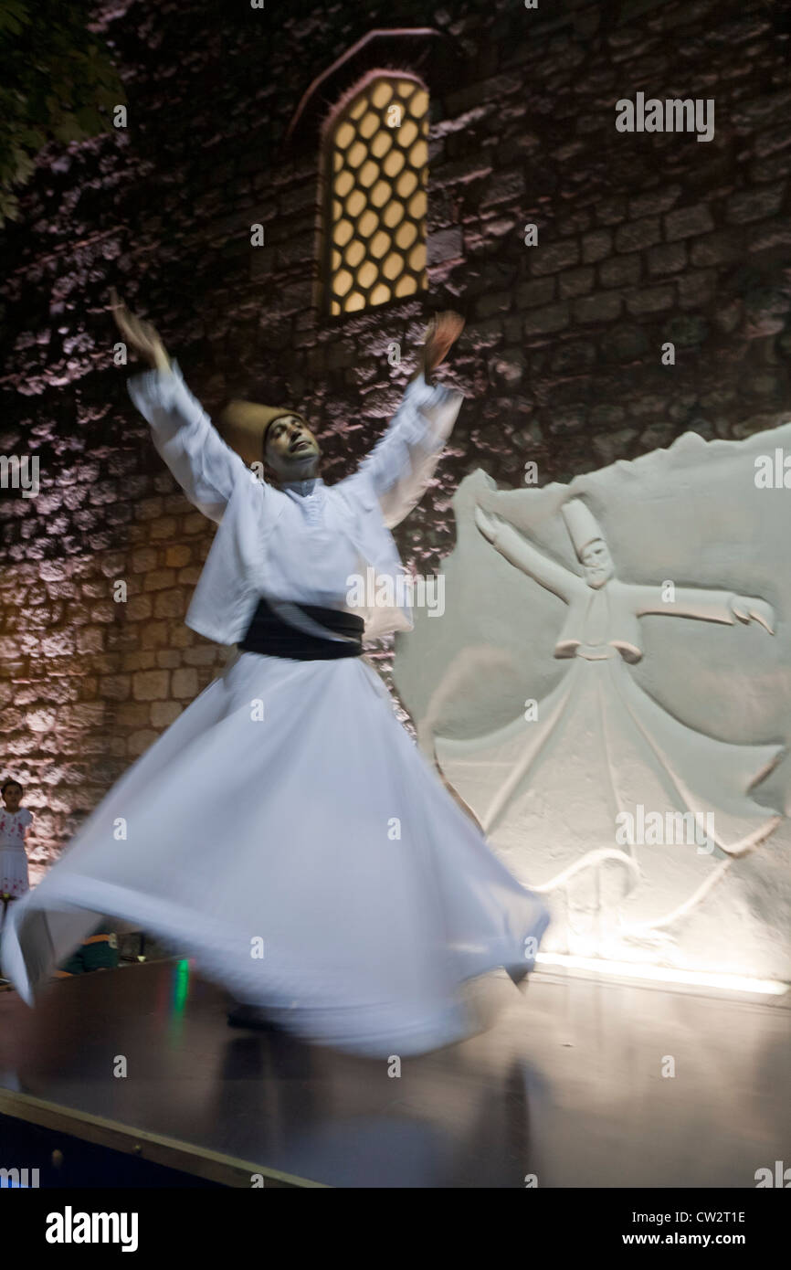 A Dervish turner performing in Istanbul Turkey - Stock Image