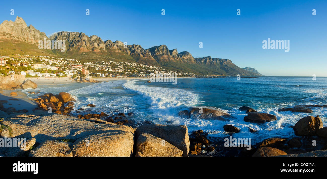 Panoramic view of Camps Bay beach with the view of the Twelve Apostles mountain range.Cape Town.South Africa - Stock Image