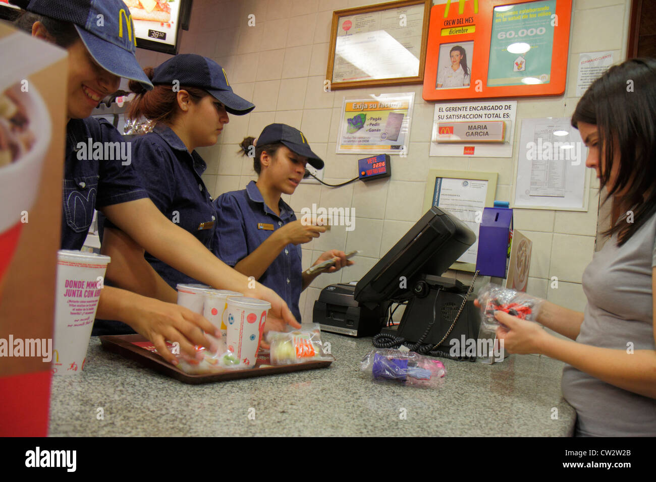Mendoza Argentina Avenida San Martin McDonald's fast food restaurant business global company counter Hispanic - Stock Image