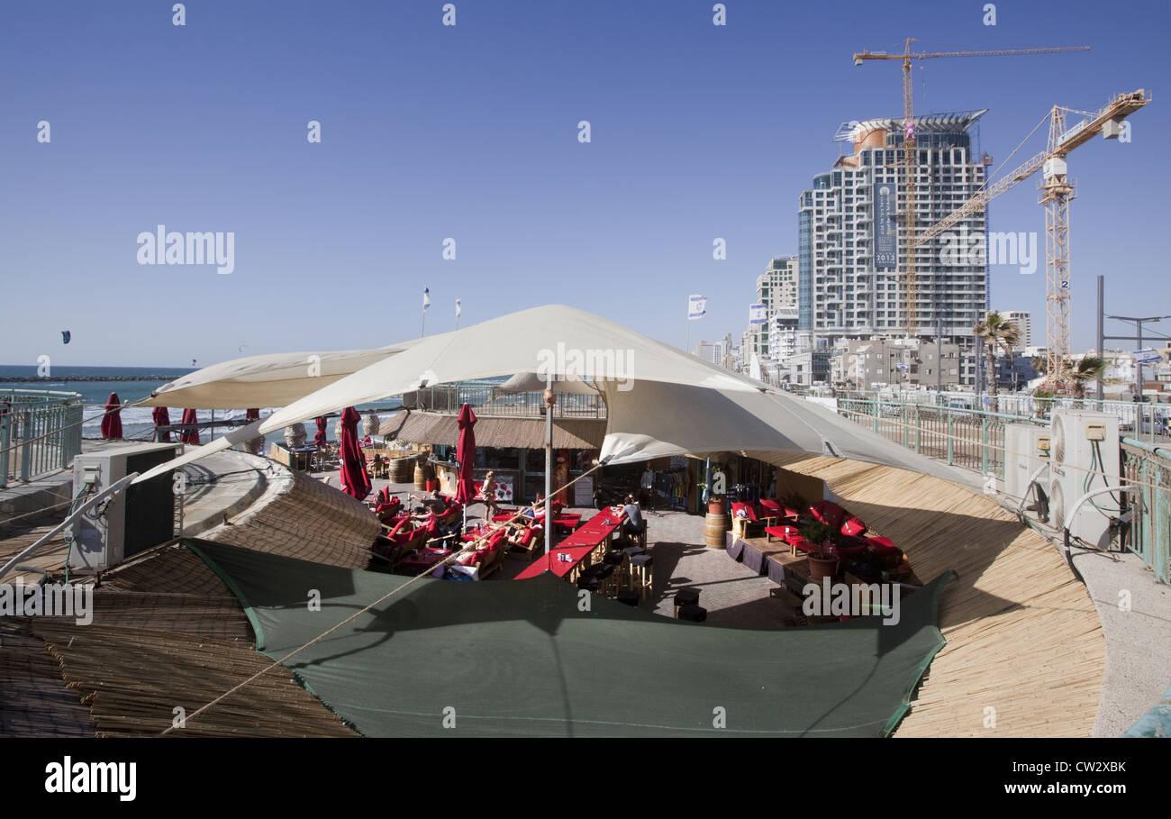 Open-air restaurant on the beach in Tel Aviv, Israel - Stock Image