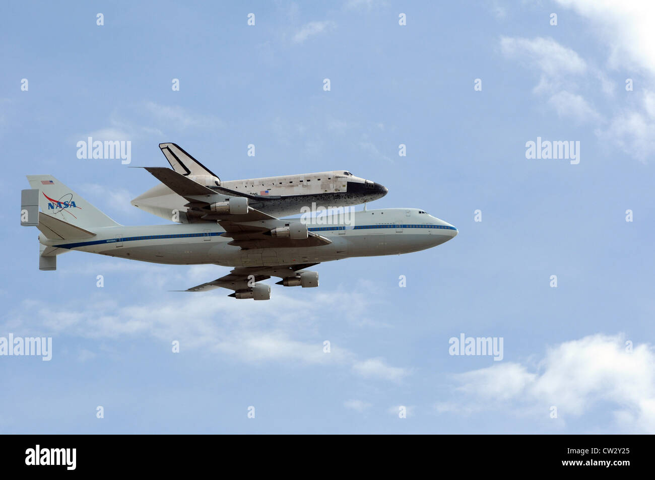 Space shuttle Discovery attached to its 747 transport passes over the nation's capital WASHINGTON, D.C. (April 17, Stock Photo