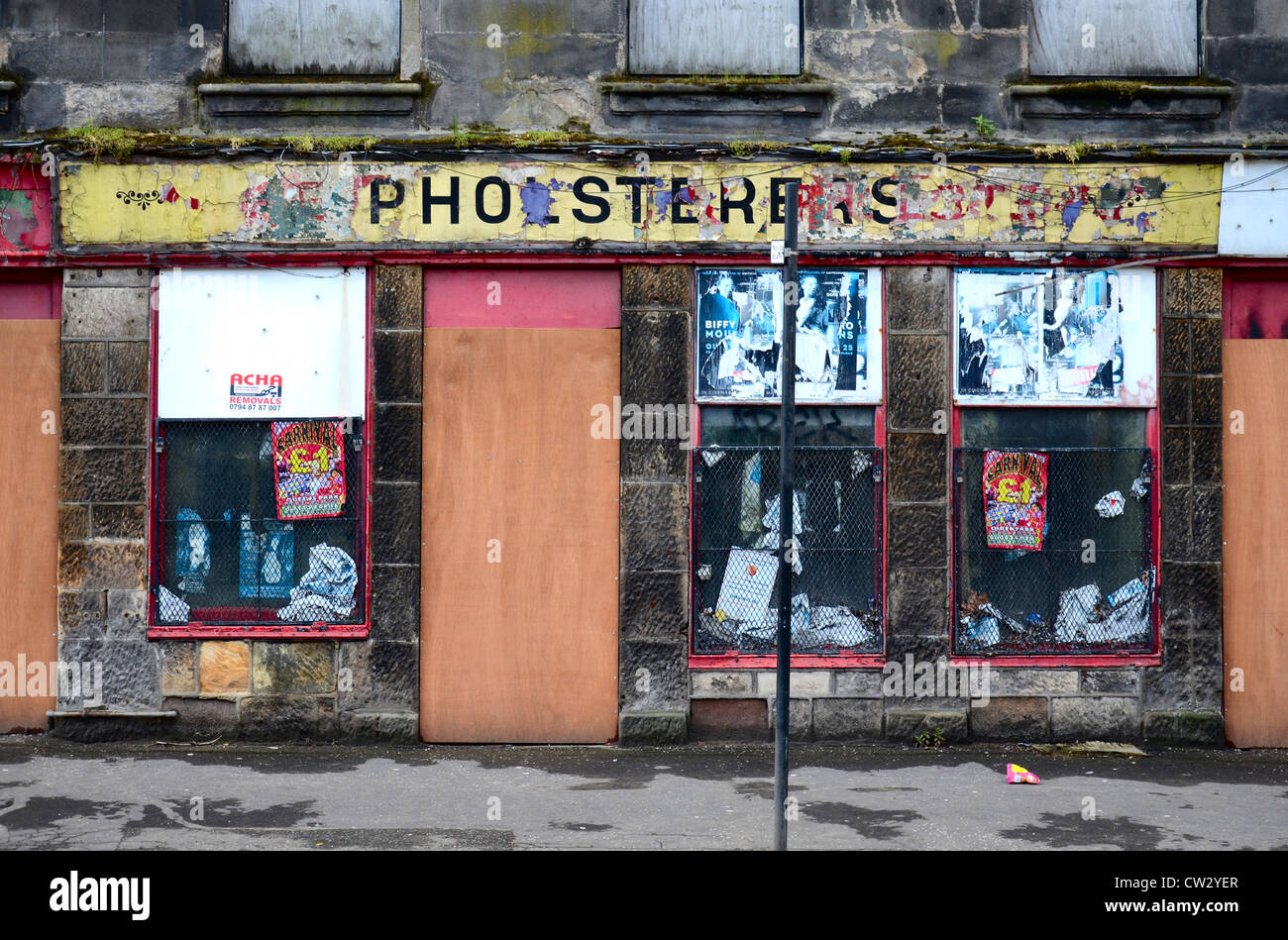 A boarded up and derelict shop in a rather down at heel end of the Merchant City area of Glasgow. Demolished September - Stock Image